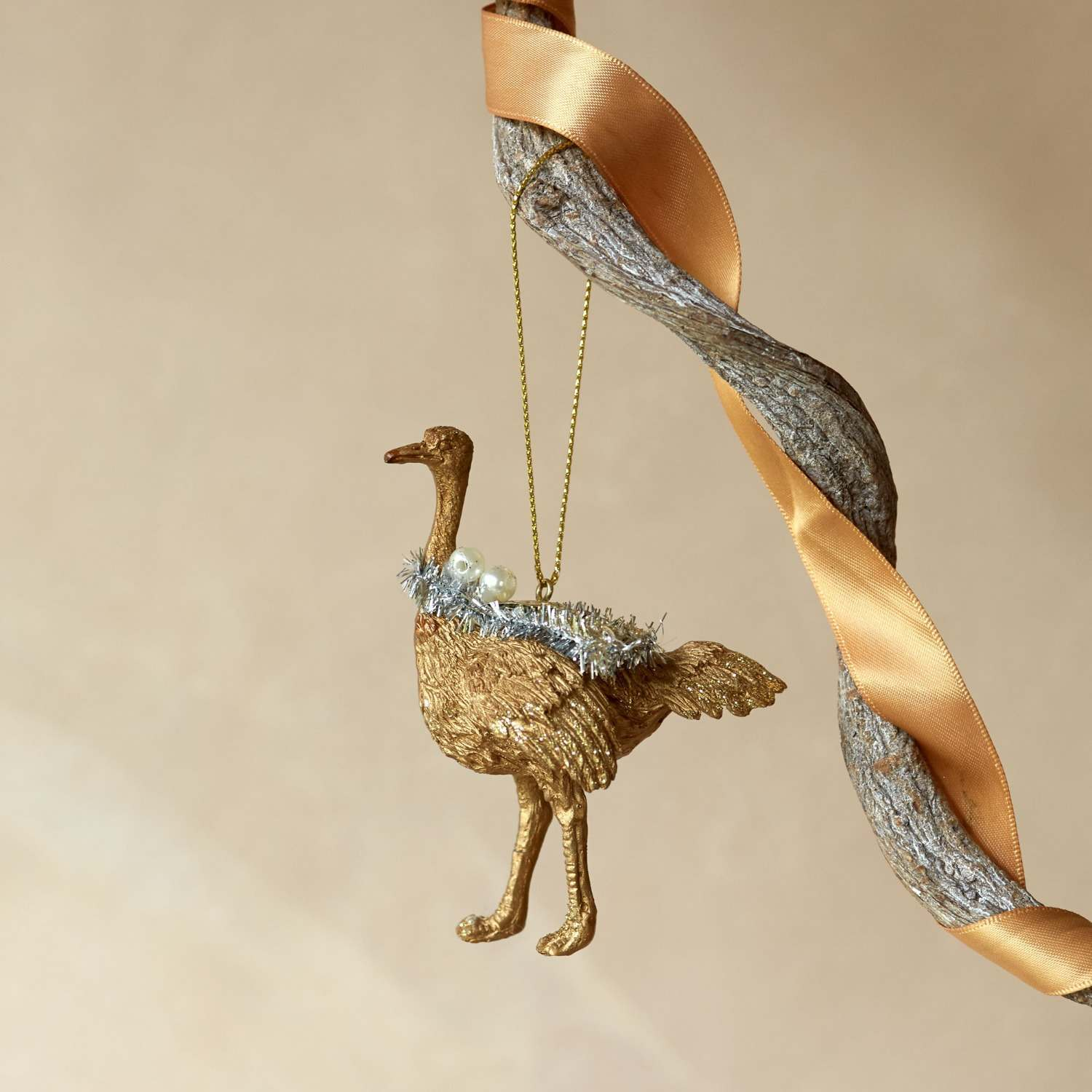 Gold Ostrich with Tinsel Decoration