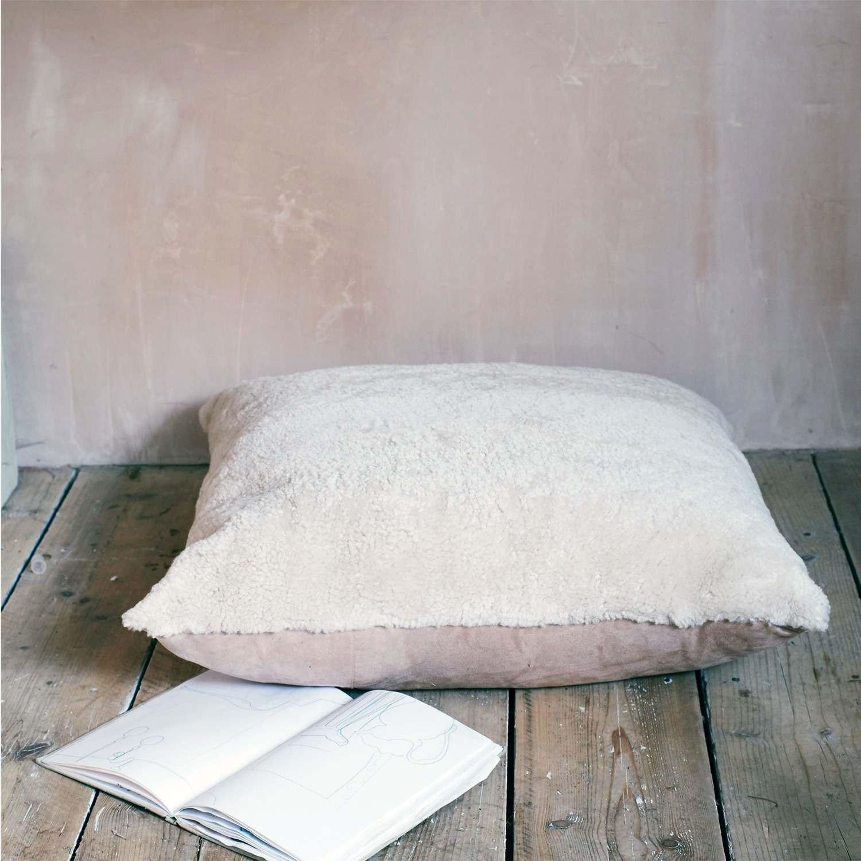 An image of Pearl Curly Sheepskin Floor Cushion