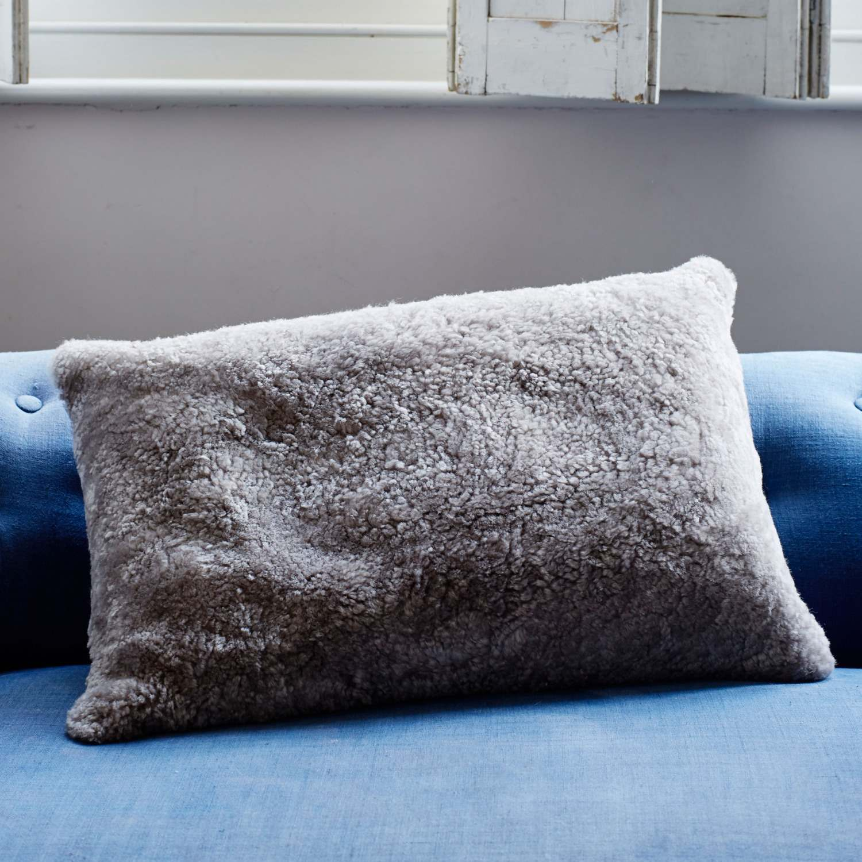 An image of Taupe Curly Sheepskin Rectangular Cushion