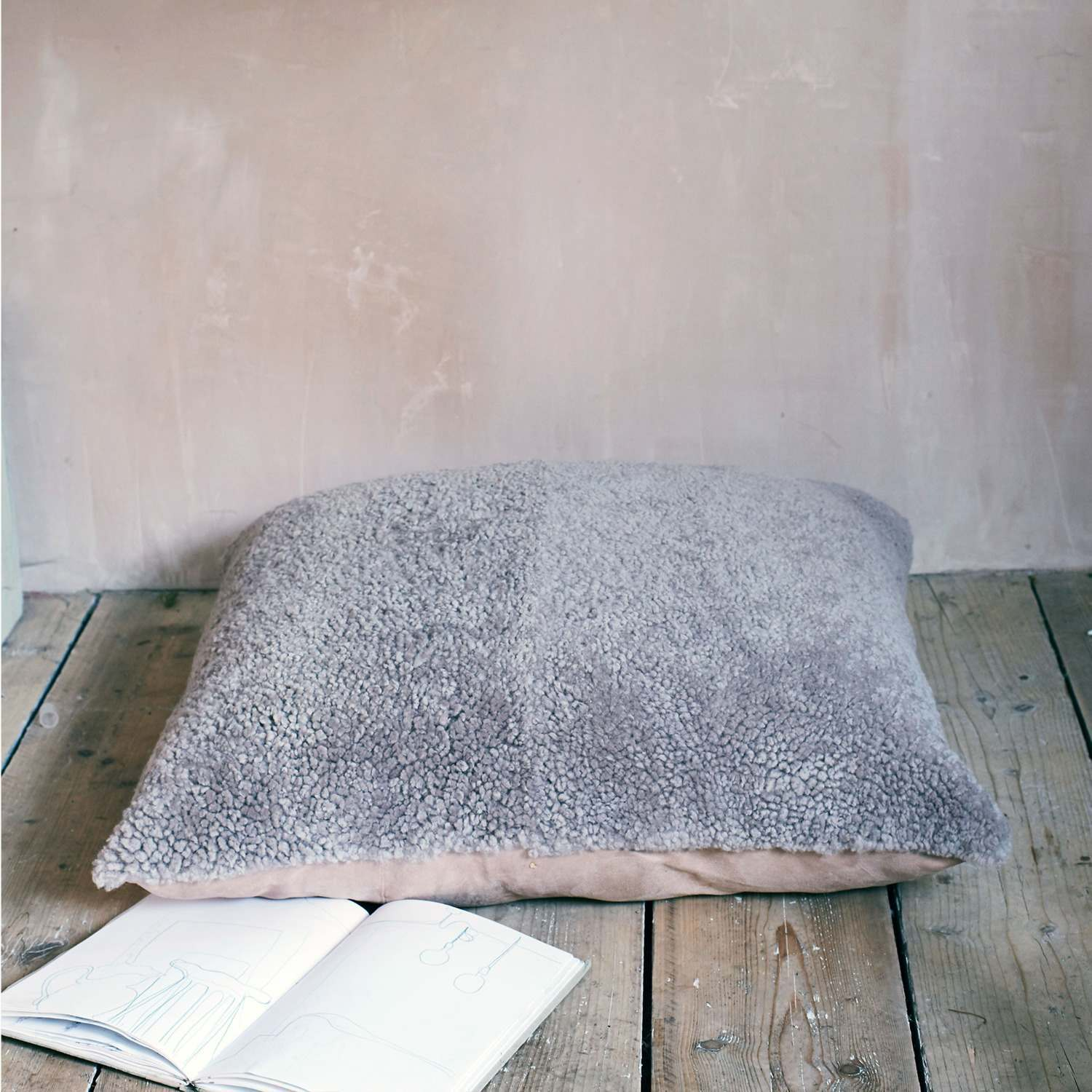 An image of Taupe Curly Sheepskin Floor Cushion